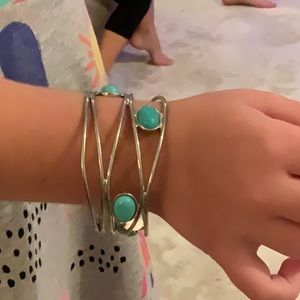 Silver metal bracelet,turquoise colored stones.
